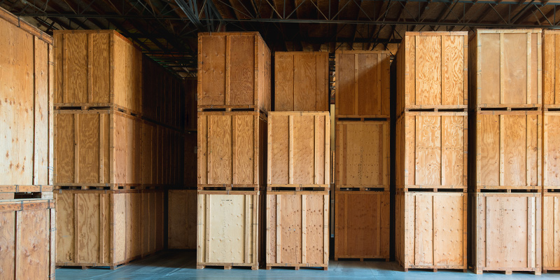 Stacked large boxes in storage facility