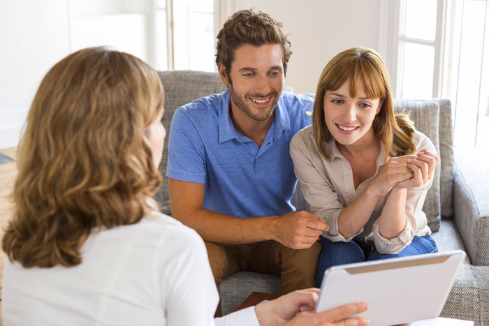 assistant helping couple with move